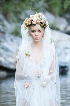 Flower crown with a cascade of blooms down the veil | Lara Hotz Photography for Hooray Magazine with styling by Stefanie Ingram, beauty by Liv Lundelius Makeup Artist and floral design by Jardine Botanic Floral Styling | see more on: http://burnettsboards.com/2014/07/ophelia-enchanting-fashion-boudoir-editorial/