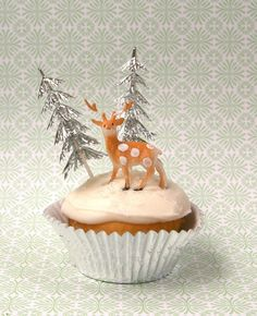 Winter Wonderland #Christmas Party themed #Cupcakes - decorated with white icing for snow and Silver glitter #trees and mini deers