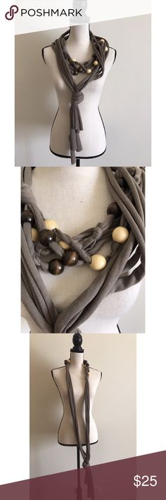 """Unique wood scarf wrap Unique wood scarf wrap This item is stunning this neck wrap scarf has wooden ball details will give any outfit a win! ONLY WORN a couple of time no flaws EUC purchased it from a boutique in Germany. ABOUT 70"""" long , Material cotton blends dark brown grayish?! color.                  🌟Reasonable offers welcome🌟            ❤️BUNDLE & SAVE 10%❤️ Accessories Scarves & Wraps"""