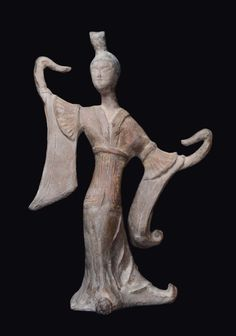 A painted pottery figure of a dancer. China, Tang Dynasty (618-906).