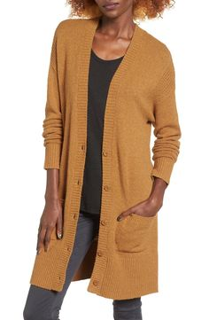 Ribbed detailing adds rich texture to a beautifully knit cardigan as cozy as the one you used to borrow from your grandpa.