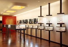 Murdock Solon Architects - FD New York - View of Gallery Room, Custom Casework, and Gold Inlay Lighting
