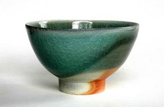 "Steve Harrison bowl from Legge Gallery 2007 exhibition 'The Hand of the Other'. He says of this bowl ""The olive green granite glaze on this bowl has been bleached by the flame to a paler blue green with a delicate carbon inclusion at the rim and foot. """