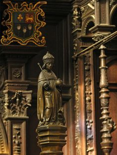 King's College, Cambridge, UK - In 1440 Henry VI founded 'The King's College of Our Lady of Eton beside Windsor' and, a year later, King's College Cambridge, which was to be supplied with scholars from Eton. This is his statuette that surmounts the lectern in the choir of King's College chapel, and behind him is the arms of Eton College.