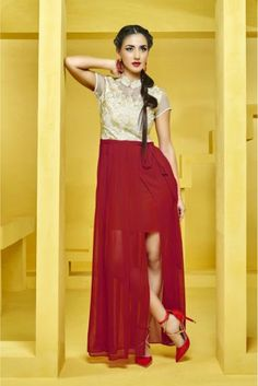 It will definitely earn you loads of compliments from onlookers. This amazing kurti has Off White and Red colored embroidery work on all over the kurti. The Off White and Red colored kurti is fabricat...