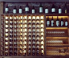 The impressive wine wall at Chalet Montfort, St Anton Wine Wall, Anton, Gourmet Recipes, Architecture, Food, Meal, Essen, Hoods, Architecture Illustrations