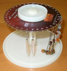 Stand for jewelry starting out with old disc. Disc for the top and spindel for the bottom!  Love this creative use of recycling!