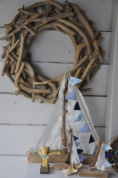 Drift wood. Next time I go to the coast to visit my redwoods I'll have to gather some for this.   IN LOVE with this wreath!!