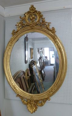 A stunning large gilt oval antique mirror www.annabellesgiltshop.co.uk
