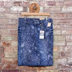 his is a Adorable jean skirt with matching pieced inset made from refashioned Size 8 Midrise Floral Acid Washed Print Denim Skirt from NEW w/tags Merona Jeans. So trendy and cute. Size 8 Waist: 34 Hips 37 Length 23.5