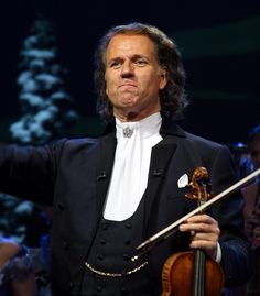 Andre Rieu - I've only had the pleasure of seeing him on PBS...but if he ever makes it to Maine (ya never know) ....I'm there! MB