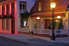 Early morning twilight cityscape photography image of the Aux Anciens Canadiens restaurant in Quebec City. The restaurant is located on La Rue Saint-Louis near Chateau Frontenac. It is the oldest house in Quebec (1675) and has been transformed into a fine dining restaurant. The restaurant features 5 dining rooms, decorated with antiques and collector art items. The Aux Anciens Canadiens provides the gourmet food lover with authentic Quebec cuisine from regional produce. www.RothGalleries.com