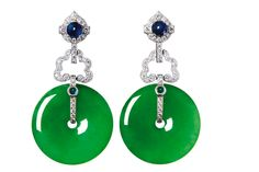 """Poly Auction Hong Kong 保利香港拍賣有限公司. A JADEITE AND DIAMOND EARRINGS Each set with a """"huaigu"""" shape jadeite with green colour and translucency, joined to a diamond hook, mounted in platinum, largest jadeite approximately 21.78 - 21.81 x 4.31mm. Accompanied by GIA report no. 2151482262 and 1156482266 dated June 7, 2013 stating that the jadeite are natural and no indications of impregnation. Estimate HK$ 480,000-580,000 US$ 61,900-74,800 Sold Price HK$ 531,000 US$ 68,500"""