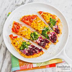 Over-the-Rainbow Pizza: This twist on a classic is colorful and customizable and teaches young chefs chopping skills.