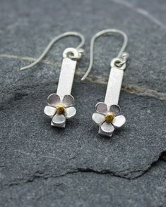 74fa20693 Silver daisy bar drop earrings with brass centres. Each earrings has an  overall length of