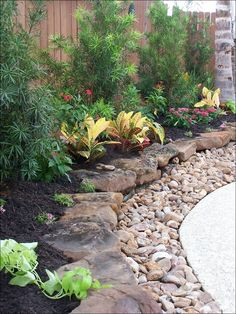 Rocky Levels - Small rocks form the initial layer of the garden, while much larger rocks act as a retaining wall for the plants. The area with plants is small – which means that it won't require a lot of water – but there's a lot of interest with the various colors and textures. This idea could work well whether you have a small backyard or a larger one that you want to frame with something creative.
