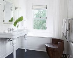 """BATH """"designed by Timothy Whealon, the master bath's sink, fittings, tub, medicine cabinet, towel warmer, and towels are all by Waterworks"""""""