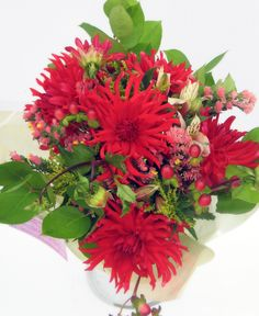Mid August.  Red Dahlias with berries and foliage.