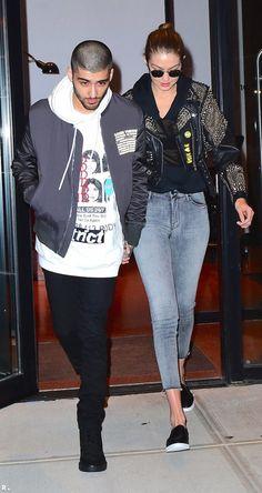 Gigi Hadid and Zayn Malik rock their bomber jackets.