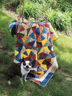 """Designer Marlous Carter used a rich palette of batiks in these fun-to-make blocks with curved seams. In keeping with the quilt's namesake, the construction is a little bit different from mainstream quiltmaking, and the resulting quilt is """"effortless cool."""" Look for Hipster in Fall Scrap '14."""