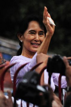 """The young bodyguards shouted for the slender woman to make a break for it. Hundreds of assailants were teeming her motorcade, demolishing her truck's window and poking sharpened bamboo sticks inside. Bur the beloved leader of Myanmar,s democracy movement- Aung San Suu Kyi lovingly called """"Aunty"""" – refused to move."""