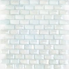 Sheet of 3/4 Inch Curved Light Blue Glass Subway Tile - This iridescent white milky subway glass tile comes with a curved surface producing a weave like 3-d effect. It has a pale blue undertone. This is a beautiful tile which produces a very clean, pristine look.