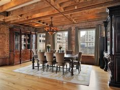 28 Laight Street. Tribeca loft apartment.  Exposed brick walls.  Natural wood beamed ceilings. dining space. NYC loft apartment.