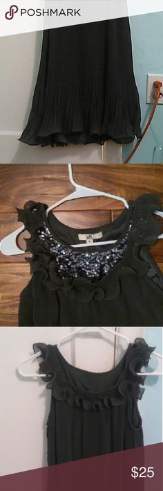 A grey dress from the YA Losangeles company A size small, grey dress in nice condition with ruffles on the top by shoulders with grey-silver sequins with a wavy look at the bottom. Dresses Mini