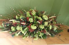 Image result for coffin top flowers naturally arranged blue white green