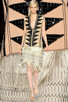 The flapper girl is having a pop culture moment with Paz de la Huerta's feisty and unpredictable Lucy Danziger in Boardwalk Empire and Carey Mulligan's turn as Daisy Buchanan in the highly anticipated Great Gatsby remake. Drawing inspiration from the roaring twenties and the Art Deco thirties, designers turned out drop-waist dresses suited for a speakeasy, but with modern twists like tulle trim and multicolored jeweled embellishments.      Etro Spring 2012