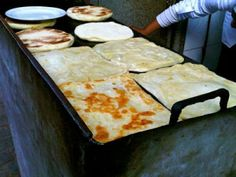 Moroccan Flatbread ~ flour, seminola, yeast; mix and knead, shape, cook on a flat griddle, enjoy!