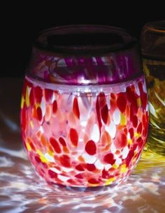 Solar Hand-blown Glass Votive Garnet by Allsop. $30.00. Available in three artisan colors: Sapphire, Amber and Garnet.. Built for outdoor use.. Embedded solar panel and LED light.. Rechargeable AAA Ni-MH battery Included.. Both elegant and captivating, Solar Votives are the unique combination of an artisan hand-blown glass votive combined with a patterned glass top with an embedded solar panel and LED light. Unlike anything else, Solar Votives are created from stunning glas...