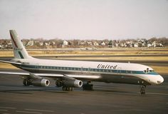 United Airlines DC-8. I had to meet one of these guys once, crazy plane to pull a jet bridge up to!
