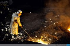 FRANCE, Grande-Synthe: A man works at the blast furnace of the ArcelorMittal steel plant of Grande-Synthe, northern France, on April 22, 2013. AFP PHOTO PHILIPPE HUGUEN