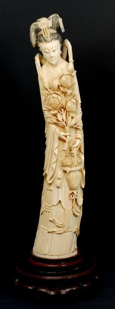 """19th C. CHINESE CARVED IVORY EMPRESS FIGURE Large antique hand carved Chinese ivory Empress figure. Intricately relief carved depicting an Empress holding flowers and basket. She is wearing layered robe and has Imperial Phoenix head dress. 19th century. Mounted on fitted wooden base. Measures 22 1/2"""" height + 3 1/2"""" base"""
