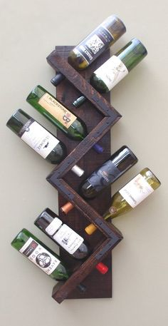 Wall Wine Rack 8 Bottle Holder Storage Display by AdliteCreations # diy wine rack easy bottle holders Zig Zag Wine Rack, Rustic Wood Wall Mounted Wine Bottle Display, Wine Bottle Storage Holder, Vertical Wine Rack Diy Wood Projects, Wood Crafts, Beginner Wood Projects, Carpentry Projects, Diy Crafts, Wine Bottle Display, Wine Bottles, Wood Wine Bottle Holder, Bottle Wall