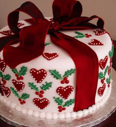 Christmas Fruit Cake, decorated with sugar-paste hearts and holly . and 'wrapped' with a red silk ribbon Christmas Themed Cake, Christmas Cake Designs, Christmas Cake Decorations, Christmas Cupcakes, Christmas Sweets, Holiday Cakes, Christmas Cooking, Noel Christmas, Christmas Goodies