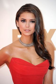 Love the understated makeup for red dress. The hair is great too, simple yet still classy.