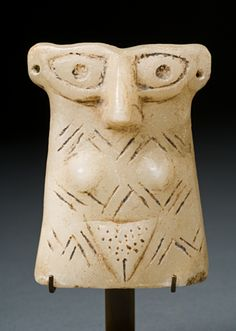 Female Stone Idol Figurine  --  Circa 3000 BCE  --  Ancient Near East  --  No further reference provided.