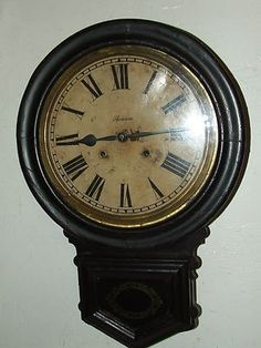 Here is a recent estate find. This is a Rare Antique 19th Century Victorian Regulator Wall Clock, made the Ansonia Clock Company New York in 1882. It has a Round Top with Drop Down Walnut Ebony Wood C