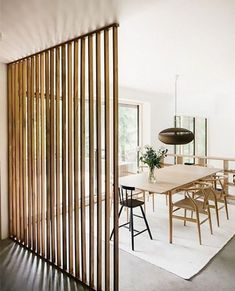 Modern dining space with a heirloom wood room divider -- Article ideas / research - modern room divider ideas for Best of Modern Design - So many good things! Fabric Room Dividers, Bamboo Room Divider, Living Room Divider, Hanging Room Dividers, Folding Room Dividers, Diy Room Divider, Wall Dividers, Modern Room Dividers, Dividers For Rooms