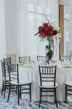 Modern, Red and White Hotel Ballroom Wedding Reception with Extra Tall Red and White Floral with Greenery Centerpiece and Brown Wood Chiavari Chairs | Hotel Wedding Venue Hyatt Regency Clearwater Beach | Tampa Bay Wedding Planner Special Moments Event Planning