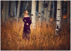 Beautiful pregnant woman has her portrait taken outside in an aspen grove in flagstaff, az