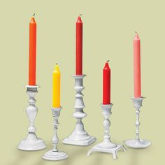 mismatched candlesticks painted white can make great decorating items when staging your home