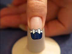 Bow tie with nail lacquer as french motif - Not in English but you can still understand the tutorial by watching it.
