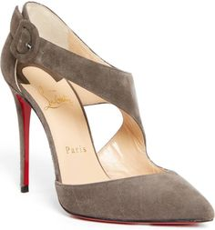 A svelte strap sweeps at an angle across the vamp of a gorgeous pump lifted by a covered stiletto heel.
