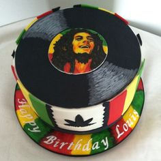 A Hand Painted Bob Marley Birthday cake #bobmarley #bobmarleycake #fondantcake #birthdaycake #jamaicancolors