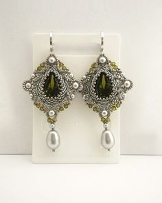 Silver beadwork earrings with Swarovski olive by MadeByAllushka