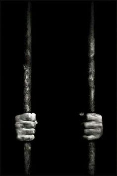 """The overpowering guilt from committing his crime prompted Raskolnikov's severe suffering, and shows how it lead to the deterioration of his mental state. This picture of a person behind bars illustrates the concept that suffering can make an individual feel """"trapped"""", such as how Raskolnikov was unable to escape his guilty conscience, unless he gained the courage to finally confess."""