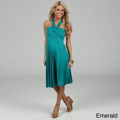 Ideal for summer or the beach, this sleeveless convertible dress can be worn in a number of ways, including as a skirt. Made from rayon and spandex, it features a pair of fabric bands that allow you to create a variety of stunning necklines.